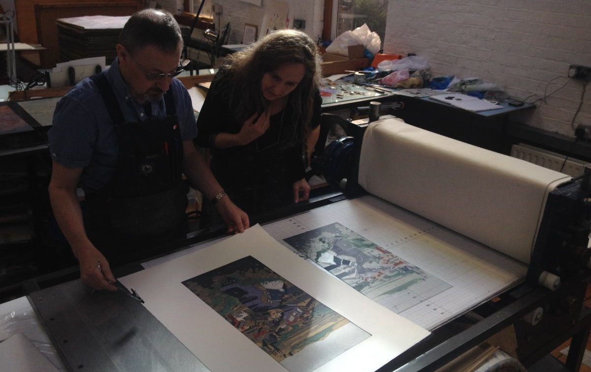 Studio Director, Robert Russell and Residency Awardee Una Sealy checking the print.